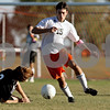 Rob Winner – rwinner@daily-chronicle.com<br /> <br /> DeKalb's Kyle Berg (15) is called for tripping after Sycamore's Zack Wallin (3)goes down during the first half in DeKalb, Ill. on Thursday October 7, 2010. DeKalb defeated Sycamore, 2-1.