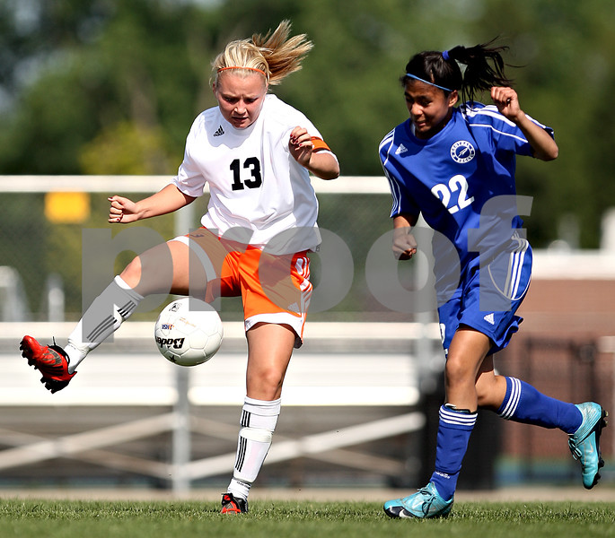 Beck Diefenbach  -  bdiefenbach@daily-chronicle.com<br /> <br /> DeKalb's Kay Smith (13, left) and Burlington Central Camille Dela Cruz (22) battle for the ball during the first half of the game at Rochelle Township High School in Rochelle, Ill., on Tuesday May 18, 2010. DeKalb defeated Burlington Central 4 to 2.