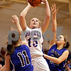 Beck Diefenbach  -  bdiefenbach@daily-chronicle.com<br /> <br /> Hinckley-Big Rock's Jes Meyer (15, center) shoots the ball during the third quarter of the little ten tournament championship game against Newark at H-BR in Hinckley, Ill., on Friday Jan. 22, 2010. H-BR defeated Newark 63 to 39.