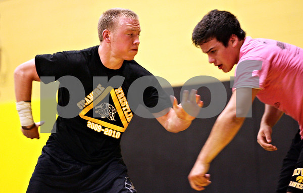 Beck Diefenbach  -  bdiefenbach@daily-chronicle.com<br /> <br /> Kyle Culton, left, wrestles with Sycamore teammate Matt Copple during practice at Sycamore High School on Monday June 28, 2010. Culton and his brother Austin will be competing in the wrestling nationals in Fargo, North Dakota on July 19.
