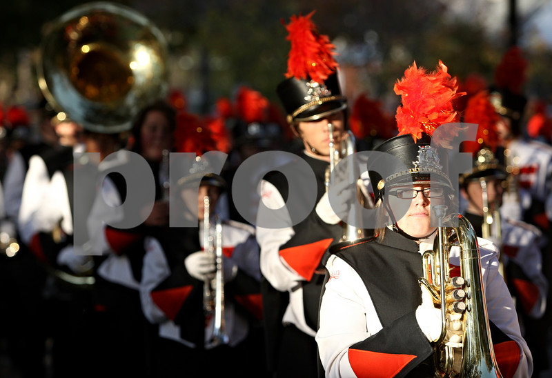 Rob Winner – rwinner@daily-chronicle.com<br /> <br /> While holding her marching baritone, Theresa Colletti (right) awaits the start of the DeKalb High School homecoming parade on Thursday October 14, 2010 in DeKalb, Ill.