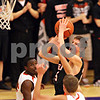 Beck Diefenbach – bdiefenbach@daily-chronicle.com<br /> <br /> DeKalb's Pat Rourke (25, top right) shoots the ball above Freeport's Austin Davis (20, bottom) during the third quarter of the IHSA Class 3A semifinal game at Hampshire High School in Hampshire, Ill., on Wednesday March 10, 2010.