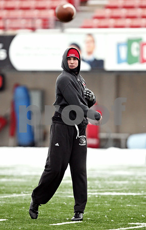 Rob Winner – rwinner@daily-chronicle.com<br /> <br /> Northern Illinois quarterback Chandler Harnish tosses a football during practice on Thursday afternoon at Huskie Stadium in DeKalb.