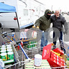 Rob Winner – rwinner@daily-chronicle.com<br /> <br /> On Wednesday afternoon, volunteer Dave Mehl (left) talks with Sycamore resident Bruce Simonsen, after Simonsen and his wife Sue (not pictured) dropped off four shopping carts filled with donations for the Freezin' for Food drive in DeKalb.
