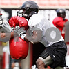 Rob Winner – rwinner@daily-chronicle.com<br /> <br /> Tommy Davis (left) blocks Landon Cox as the Huskies practiced special team plays on Friday August 13, 2010 at Huskie Stadium in DeKalb, Ill.