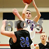Rob Winner – rwinner@daily-chronicle.com<br /> <br /> Genoa-Kingston's Bret Lucca puts up two points in the first quarter in Genoa on Monday night. Genoa-Kingston went on to defeat Hinckley-Big Rock, 72-51.