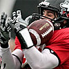 Rob Winner – rwinner@daily-chronicle.com<br /> <br /> Garrett Barnas (center) intercepts a pass intended for Anthony Johnson (13) at the start of Northern's final spring football practice in DeKalb, Ill. on Saturday April 24, 2010.