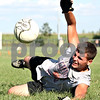 Rob Winner – rwinner@daily-chronicle.com<br /> <br /> Goalkeeper Justin Salazar of Hinckley-Big Rock blocks a shot during practice on Monday August 17, 2010 in Hinckley, Ill.