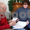 Rob Winner – rwinner@daily-chronicle.com<br /> Louis Meinert, 86, sorts his mail with his daughter Margie Gommel at Meinert's home in DeKalb, Ill. on Saturday February 6, 2010.