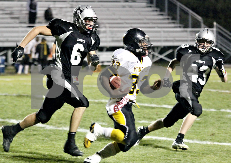 Wendy Kemp - For The Kane County Chronicle<br /> Kaneland's Tyler Callaghan (left) and Kory Harner (right) chase down King College Prep's Devon Robinson during Friday's playoff game.<br /> Maple Park 10/29/10
