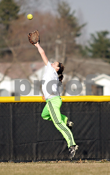 Beck Diefenbach  -  bdiefenbach@daily-chronicle.com<br /> <br /> Indian Creek junior Anna Striker leaps to catch the ball during practice at Indian Creek High School in Shabbona, Ill., on Friday March 19, 2010.