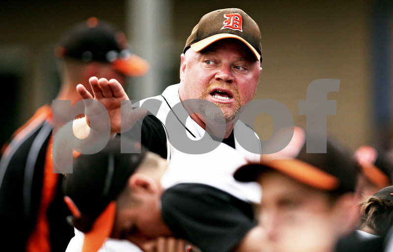 Rob Winner – rwinner@daily-chronicle.com<br /> <br /> DeKalb baseball coach Justin Keck talks to his players after the fifth inning during the IHSA Class 3A Augustana College Super-Sectional in Moline, Ill. on Monday June 7, 2010.