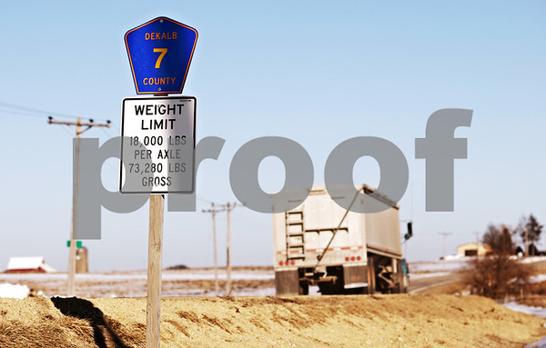 Beck Diefenbach - bdiefenbach@daily-chronicle.com<br /> <br /> A semi-truck passes a new warning sign declaring the DeKalb County weight limitations at the entrance to the county on the corner of Perry Road and West County Line Road in Lee, Ill.,  on Wednesday March 3, 2010.