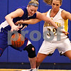 Beck Diefenbach  -  bdiefenbach@daily-chronicle.com<br /> <br /> Hinckley-Big Rock's Jenna Thorp (20, left) tries to keep the ball away from Stockton's Morgan Werkheiser (32, right) during the first quarter of the IHSA Class 1A Super Sectional championship game at Judson University in Elgin, Ill., on Monday Feb. 22, 2010.