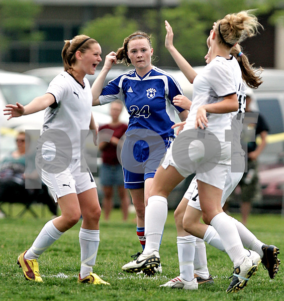 Beck Diefenbach  -  bdiefenbach@daily-chronicle.com<br /> <br /> Sycamore's Katelyn Brown (11, left) celebrates with teammates after defeating Rosary in the IHSA Class 2A Hampshire Sectional Semi-final game at Hampshire High School in Hampshire, Ill., on Tuesday May 25, 2010. Sycamore defeated Rosary 3 to 1.