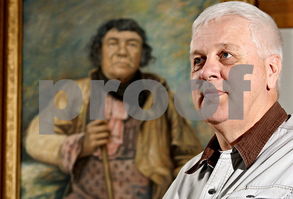 Rob Winner – rwinner@daily-chronicle.com<br /> Denny Sands stands in front of a portrait of Chief Shabbona on Thursday January 21, 2010 in Shabbona, Ill. Sands will be inducted into the Illinois Conservation Society's Outdoors Hall of Fame in March.