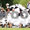 Rob Winner – rwinner@daily-chronicle.com<br /> <br /> Catcher Jake Lemay (top) jumps on top of a pile of DeKalb players at the end of the IHSA Class 3A Augustana College Super-Sectional on Monday June 7, 2010. DeKalb defeated Galesburg, 8-4.