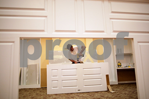 Beck Diefenbach  -  bdiefenbach@daily-chronicle.com<br /> <br /> Mike Lewis of Jensen Construction assembles a door for the new Lincolnshire Place Alzheimer's Disease facility in Sycamore on Monday July 26, 2010.