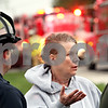 Beck Diefenbach  -  bdiefenbach@daily-chronicle.com<br /> <br /> Karen Watson talks with firefighters as her family's home is destroyed by fire in rural DeKalb, Ill., on Friday April 30, 2010.