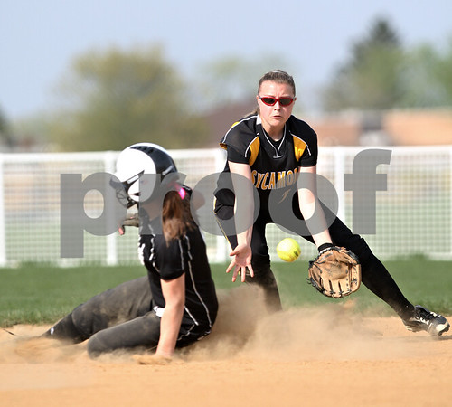 Beck Diefenbach  -  bdiefenbach@daily-chronicle.com<br /> <br /> Kaneland's Delaney Vest (1, left) slides safe into second base as Sycamore's Meranda Brashears (25) fields the ball during the first inning of the game at Sycamore High School in Sycamore, Ill., on Tuesday April 20, 2010. Kaneland defeated Sycamore 10 to 0 in six innings.