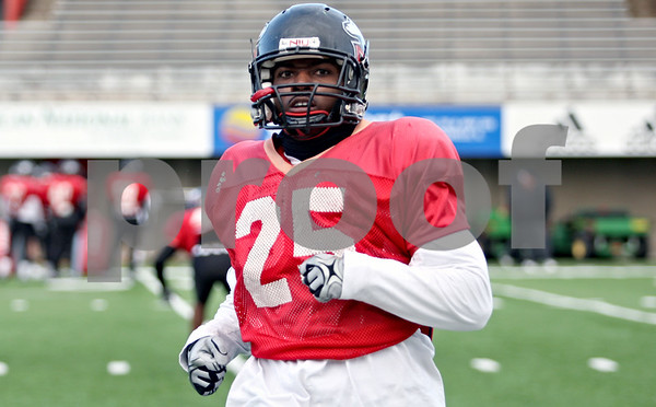 Rob Winner – rwinner@daily-chronicle.com<br /> <br /> NIU strong safety Tracy Wilson works out during practice at Huskie Stadium in DeKalb, Ill. on Thursday April 8, 2010.