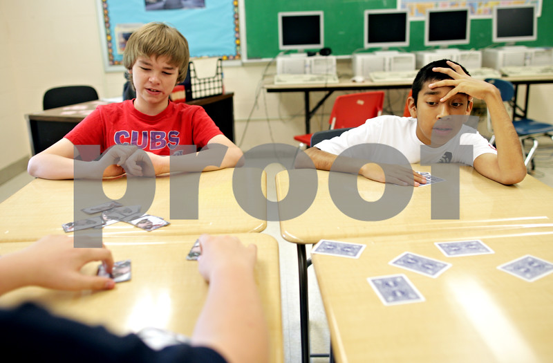 Beck Diefenbach  -  bdiefenbach@daily-chronicle.com<br /> <br /> Griffin Johnson, left, and Sergio Renteria play a card game meant to educate the children on the importance of decision making skills during the Spartan Reach summer program at Sycamore High School in Sycamore, Ill., on Wednesday June 30, 2010.