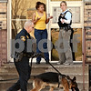 Beck Diefenbach  -  bdiefenbach@daily-chronicle.com<br /> <br /> A Dekalb County Sheriff Deputy and K-9 unit search the area around an apartment building at 915 Crane Dr. in DeKalb, Ill.,  following a report of shots fired on Tuesday March 23, 2010.