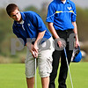 Beck Diefenbach – bdiefenbach@daily-chronicle.com<br /> <br /> Hinckley-Big Rock's Austin Hard putts on the 7th hole during the Little 10 Conference Meet at the Hughes Creek Golf Course in Elburn, Ill., on Wednesday Sept. 22, 2010.