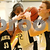 Rob Winner – rwinner@daily-chronicle.com<br /> Sycamore's Tessa Strack (right) controls a defensive rebound during the second quarter. Sycamore defeated Kaneland, 62-52.