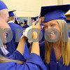 JEFF KRAGE/FOR THE DAILY-CHRONICLE<br /> Hinckey-Big Rock graduate Maxzine Rossler (right) has her cap adjusted by Carolyn Sanders before the start of Sunday's ceremony.<br /> Hinckley 5/30/10