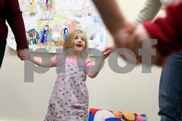 Rob Winner – rwinner@daily-chronicle.com<br /> Three-year-old Lola Atkinson, of Plano, holds hands during a Sunday school lesson at St. John's Lutheran Church in Somonauk, Ill. on February 21, 2010.