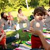 Beck Diefenbach  -  bdiefenbach@daily-chronicle.com<br /> <br /> Viktor Tansley, 8 months, stands up with help from his mother Michelle, of Sycamore, during a Crunchie Moms playdate at Sycamore Lake Rotary Park in Sycamore, Ill., on Thursday July 29, 2010.