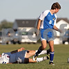 Beck Diefenbach – bdiefenbach@daily-chronicle.com<br /> <br /> Genoa-Kingston's David Pizano (9, left) hits the ground after going up against Rockford Christian's Samuel Geddes (6) during the first half of the game at G-K High School in Genoa, Ill., on Thursday Sept. 30, 2010. G-K defeated Rockford Christian 1 to 0.