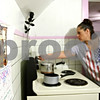 Rob Winner – rwinner@daily-chronicle.com<br /> <br /> A calendar featuring a Norman Rockwell painting of Thanksgiving hangs in the kitchen of Elizabeth Kopec's home in Malta on Wednesday. Kopec, a mother of two, has a LINK card which was not credited at the beginning of the month.