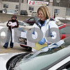 Rob Winner – rwinner@daily-chronicle.com<br /> Kelly Wituk (front) and Katie Moisa, both of Maple Park and cousins of missing adult Bradley Olsen, place flyers of Olsen on vehicles parked near West Lincoln Highway in DeKalb, Ill. on Saturday January 16, 2010. On January 20, Bradley Olsen of Maple Park will have been missing for three years. He was last seen leaving what used to be Bar One in DeKalb.