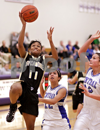 Beck Diefenbach  -  bdiefenbach@daily-chronicle.com<br /> <br /> Sycamore's Lake Kwaza (11, left) shoots the ball ahead of Burlington Central's  Araceli Munoz (22, center) and Taylor Colby (42) during the fourth quarter of the IHSA Class 3A Regional playoff game at Rochelle Township High School in Rochelle, Ill, on Monday Feb. 15, 2010.