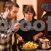 Kyle Bursaw – kbursaw@daily-chronicle.com<br /> <br /> Kevin Ballantine tastes his mother Diane DeMers' potato dish for seasoning. The dish was being prepared for family and friends to celebrate Pooja Ballantine's 18th birthday on Tuesday, Dec. 28, 2010.