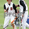 Beck Diefenbach  -  bdiefenbach@daily-chronicle.com<br /> <br /> DeKalb's Brian Sisler (right) congratulates Kevin Sullivan (6, left) after Sullivan scored a run to take the lead during the sixth inning of the game against Geneva at DeKalb High School in DeKalb, Ill., on Wednesday May 12, 2010. DeKalb defeated Geneva 4 to 3.