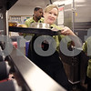 Kyle Bursaw – kbursaw@daily-chronicle.com<br /> <br /> Brenda Luttrell loads up completed trays of food run to patient's rooms as Gerry James prepares more trays in the background in the kitchen at Kishwaukee Community Hospital in DeKalb, Ill. on Thursday, Nov. 25, 2010.