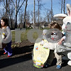 Rob Winner – rwinner@daily-chronicle.com<br /> <br /> Steffini McDowell (left), 4, and her brother Colton McDowell, 2, both of Genoa, received a hug and a basket from the Easter Bunny on Tuesday March 30, 2010 in Genoa, Ill. The Easter Bunny teamed up with the Genoa Park District for the basket delivery service on Tuesday.
