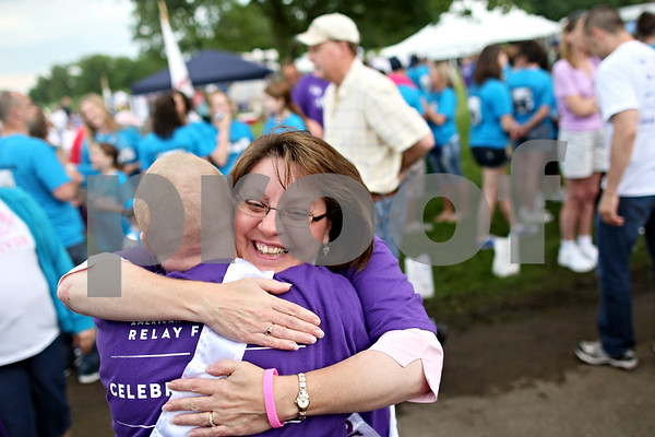 Beck Diefenbach  -  bdiefenbach@daily-chronicle.com<br /> <br /> Cancer survivors Cheryl Chilson, center, of Sycamore, and Christy Eastman, left, of Mount Prospect, embrace after meeting for the first time at  Relay for Life at Sycamore Park in Sycamore, Ill., on Friday June 18, 2010.
