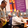 Beck Diefenbach  -  bdiefenbach@daily-chronicle.com<br /> <br /> Executive director Nathan Scott, left, works with volunteer Valarie Talsma on finding donated goods and services for clients in the offices of Love INC in DeKalb, Ill., on Thursday March 11, 2010.