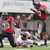 Rob Winner – rwinner@daily-chronicle.com<br /> <br /> Northern Illinois cornerback Patrick George (33) wraps up Central Michigan receiver Cody Wilson during the second quarter in DeKalb, Ill. on Saturday October 23, 2010. DeKalb went on to defeat Central Michigan, 33-7.