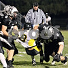 Wendy Kemp - For The Kane County Chronicle<br /> Kaneland's Tyler Callaghan (left) and Blake Serpa (right) sack King College Prep's quarterback Kendal Harris during Friday's playoff game.<br /> Maple Park 10/29/10