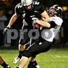 Beck Diefenbach – bdiefenbach@daily-chronicle.com<br /> <br /> Kaneland's Blake Serpa (2, left) is tackled by DeKalb's Troy Talaga (1) during the first quarter of the game at Kaneland High School in Maple Park, Ill., on Friday Oct. 1, 2010.