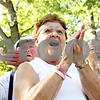 Rob Winner – rwinner@daily-chronicle.com<br /> <br /> Carol Cleveland, of New Lebanon, cheers on her granddaughter during the Kingston Fest 2010 Kardboard Boat Regatta on Saturday July 17, 2010 in Kingston, Ill.