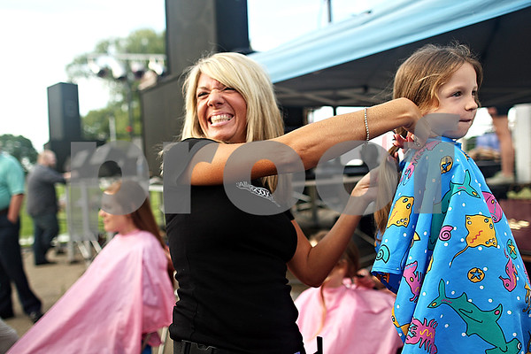 Beck Diefenbach  -  bdiefenbach@daily-chronicle.com<br /> <br /> Jen Scott, left, owner of Hair Productions, cuts off hair for Hope Nordbrock, 4, to be donated to Pantene Beautiful Lengths before the start of Relay for Life at Sycamore Park in Sycamore, Ill., on Friday June 18, 2010.