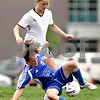 Beck Diefenbach  -  bdiefenbach@daily-chronicle.com<br /> <br /> Sycamore's Katelyn Brown (11, top) takes the ball away from Rosary's Kaitlin Johnson (12) during the second half of the IHSA Class 2A Hampshire Sectional Semi-final game at Hampshire High School in Hampshire, Ill., on Tuesday May 25, 2010. Sycamore defeated Rosary 3 to 1.