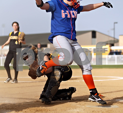 Beck Diefenbach  -  bdiefenbach@daily-chronicle.com<br /> <br /> Genoa-Kingston's Ashley Paulsen (13) is safe at home after dodging an attempted tag by Sycamore catcher Samantha Navarro during the top of the third inning at Sycamore High School in Sycamore, Ill., on Thursday April 1, 2010. G-K defeated Sycamore 9 to 2.