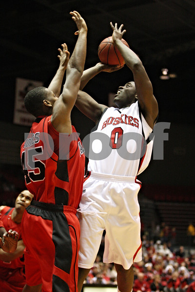 Rob Winner – rwinner@daily-chronicle.com<br /> NIU's Michael Fakuade (right) takes a shot over Ball State's Jarrod Jones during the first half of their game on Saturday February 13, 2010 in DeKalb, Ill.